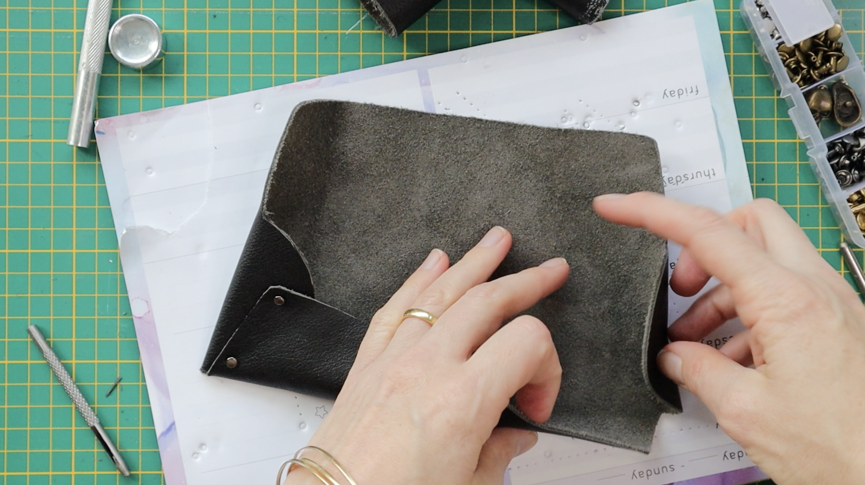 leather pencil case diy adding rivets